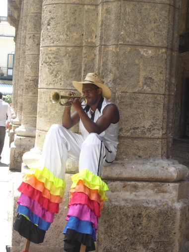 Colourfully dressed trumpet player, Havana, Cuba