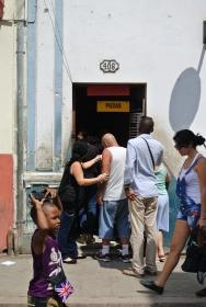 Locals queue for pizza, Havana