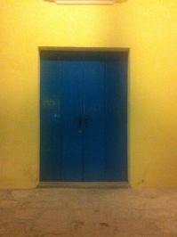 Blue door, yellow wall in Havana