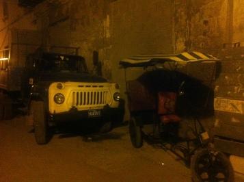 Truck and tuk tuk in an alleryway in Havana