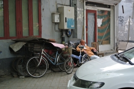 A sleeping man in the Hutong district Beijing