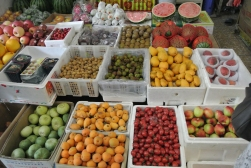 A rainbow of fresh, tropical fruit on a market stall