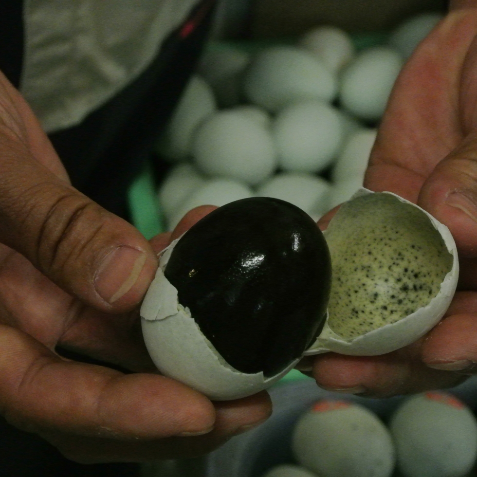 Revealing the black inside of a 100 year egg, Beijing