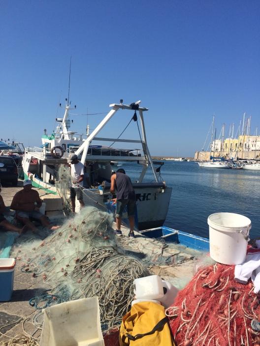 Fishermen at Gallipoli harbour, Puglia, Italy