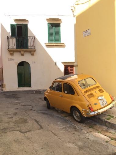Vintage yellow Fiat 500, Gallipoli , Italy